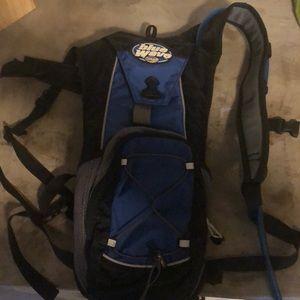 Camelbak blue wave bladder and backpack